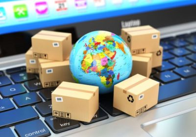 48900767 - shipping, delivery and logistic concept. earth and cardboard boxes on laptop keyboard. online technology. 3d